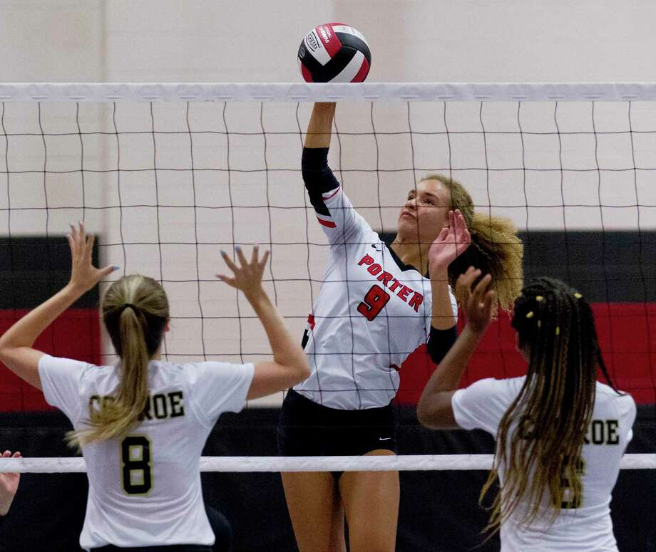 Josey Nunn #9 of Porter gets a shot over outside hitter Abby Calhoun (8) and middle blocker T'lisha Kennedy (6) in the first set of a match during the Spring ISD Varsity Volleyball Classic at Westfield High School, Thursday, Aug. 15, 2019, in Houston. Photo: Jason Fochtman, Houston Chronicle / Staff Photographer / Houston Chronicle