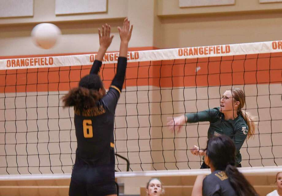 Players compete in an early season volleyball game at Orangefield Thursday afternoon.  Photo taken on Thursday, 08/15/19. Ryan Welch/The Enterprise Photo: Ryan Welch, Beaumont Enterprise / The Enterprise / © 2019 Beaumont Enterprise