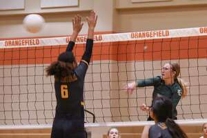 Players compete in an early season volleyball game at Orangefield Thursday afternoon.  Photo taken on Thursday, 08/15/19. Ryan Welch/The Enterprise