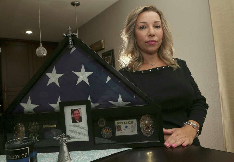 Rebecca Tiger, a former Phoenix police officer, is the widow of Craig Tiger, a Phoenix police officer who committed suicide a few years ago following a fatal shooting he was involved in, shown her home Monday, July 1, 2019, in Scottsdale, Ariz. Officer Craig Tiger suffered from post-traumatic stress disorder after fatally shooting a man while on duty back in 2012, and took his own life two years later. (AP Photo/Ross D. Franklin) Photo: Ross D. Franklin / Copyright 2019 The Associated Press. All rights reserved