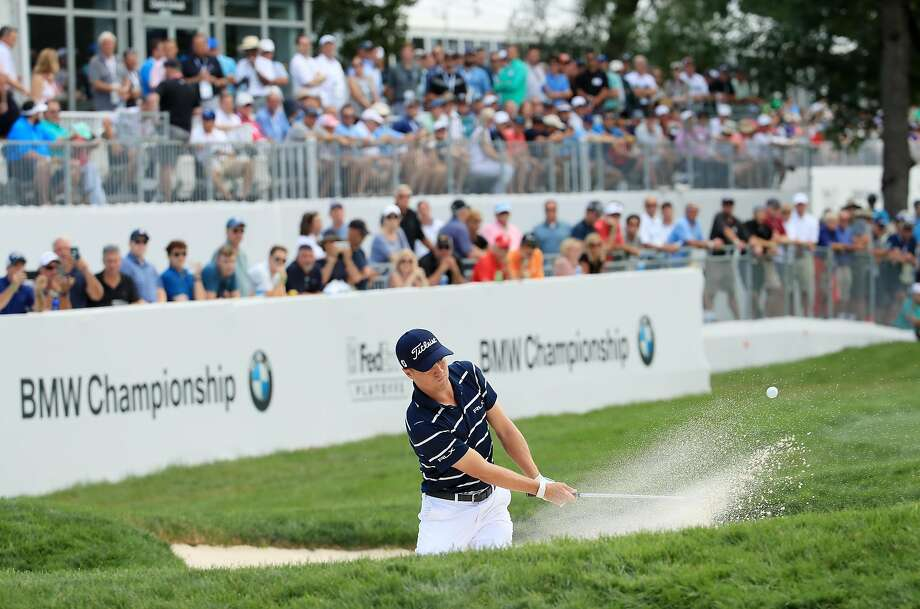 BMW Championship co-leader Justin Thomas plays his third shot from a bunker on the 18th hole during the first round. He shot 7-under 65. Photo: Andrew Redington / Getty Images