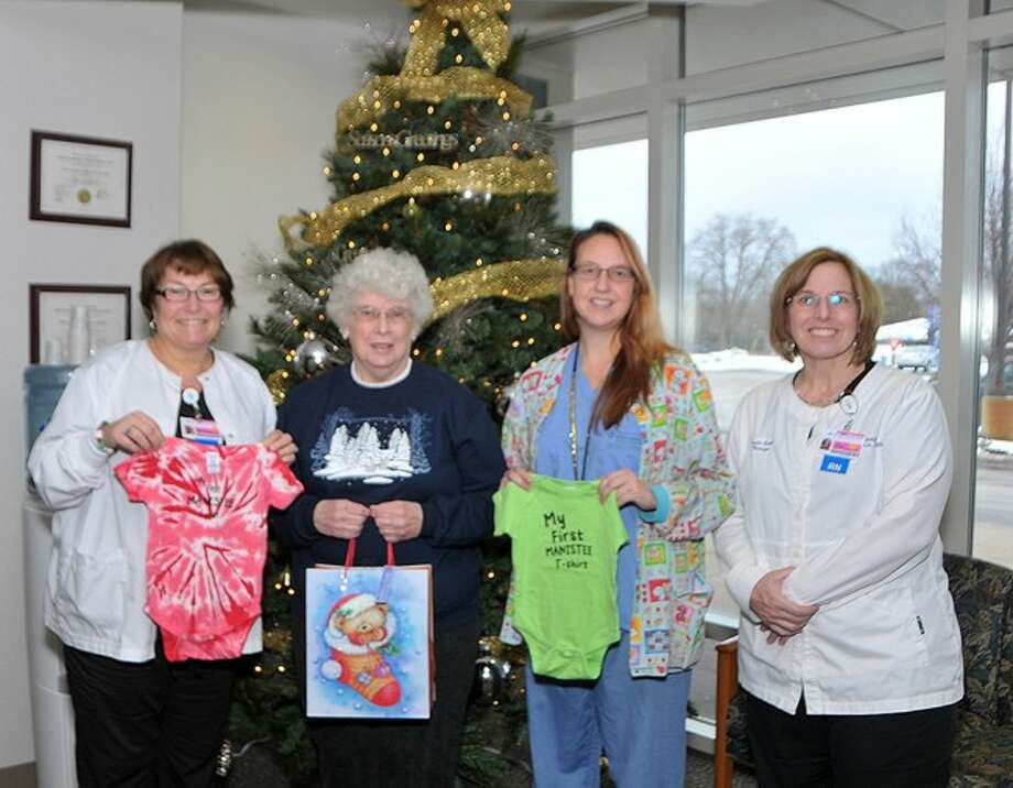 WELCOME TO THE WORD: The Manistee Kiwanis Club recently donated onesies for newborns at West Shore Medical Center. From left to right; Clinical Coordinator, Laura Acton, RN; Manistee Kiwanis Club Board member Janet Gutowski; OB nurse Betsy Saylor, RN; Inpatient Services Manager, Laura Lund, RN.