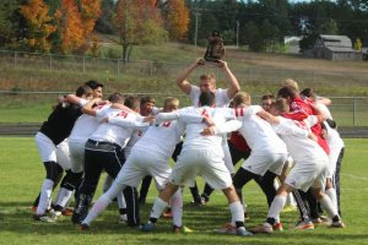 A FIRST TIME FOR EVERYTHING: The Benzie Central soccer team celebrates its first every district title on its way to an appearance in the regional final.
