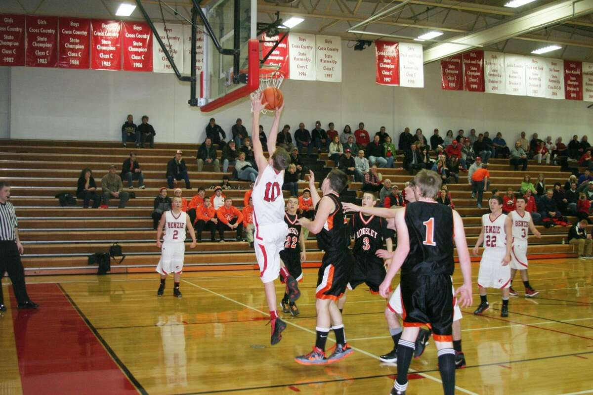 Almost dunking: Freshman Noah Yacks (10) fights to put the ball in during the big win over Kingsley. (Photo/Bryan Warrick)