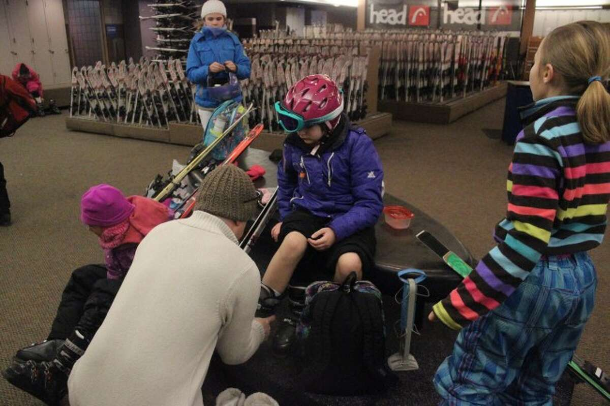 FIRST TIME ON THE SLOPES: Crystal Mountain workers helped the Platte River Elementary School students prepare for their first time skiing.