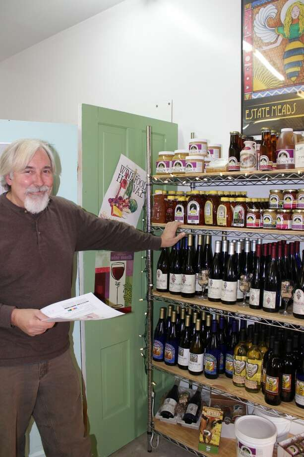 """St Ambrose: Doug Coster, sales manager for St. Ambrose Cellars, said the market for mead, in Benzie and beyond, is doing quite well. So well, in fact, that they may soon begin distribution on the East Coast. St. Ambrose, which started marketing mead 2 years ago, makes traditional meads from honey and water, as well as meads with natural fruit flavors added. Acoustic Mead, a meadery in Lake Ann, creates meads of a different type; carbonated meads with a lower alcoholic content that are more """"quaffable"""", according to Acoustic owner Bruce Grossman. (Photo by Colin Merry)"""