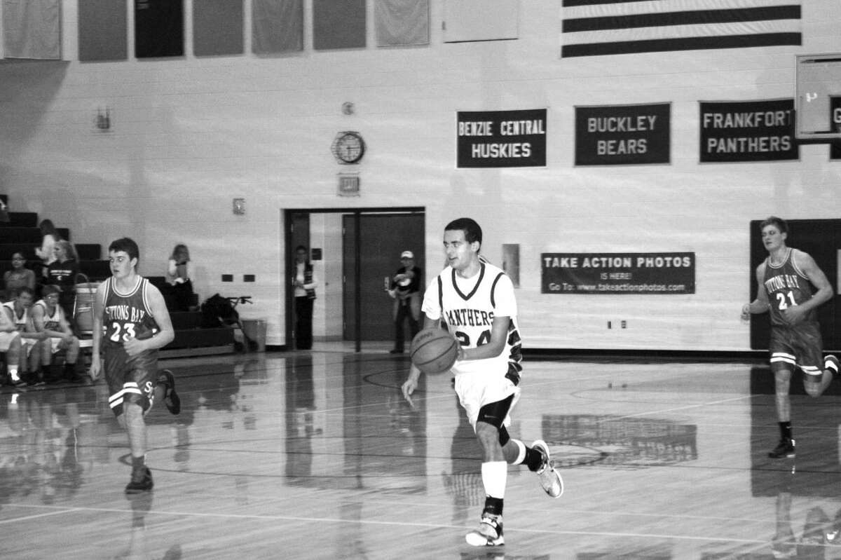 FKT JV going on offense: Isaac Ryan-McKinnon takes the ball on the offensive. He had 13 points in the game. (Photo/Bryan Warrick)