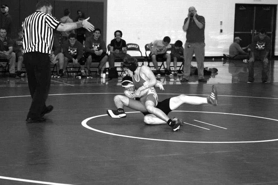 BENZONIA: The Huskies hosted a three-team match and finished the day with a win and a loss. Benzie started the day with a big win over Lake City, 48-21. In the second match, there were several great bouts but the Huskies fell 51-28. (Photos/Bryan Warrick)