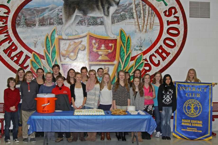 WHAT A PARTY: The charter members of the new Interact Club at Benzie Central Middle School stand together behind the inauguration cake and other refreshments during the club's opening ceremony with the Benzie Sunrise Rotary Club.