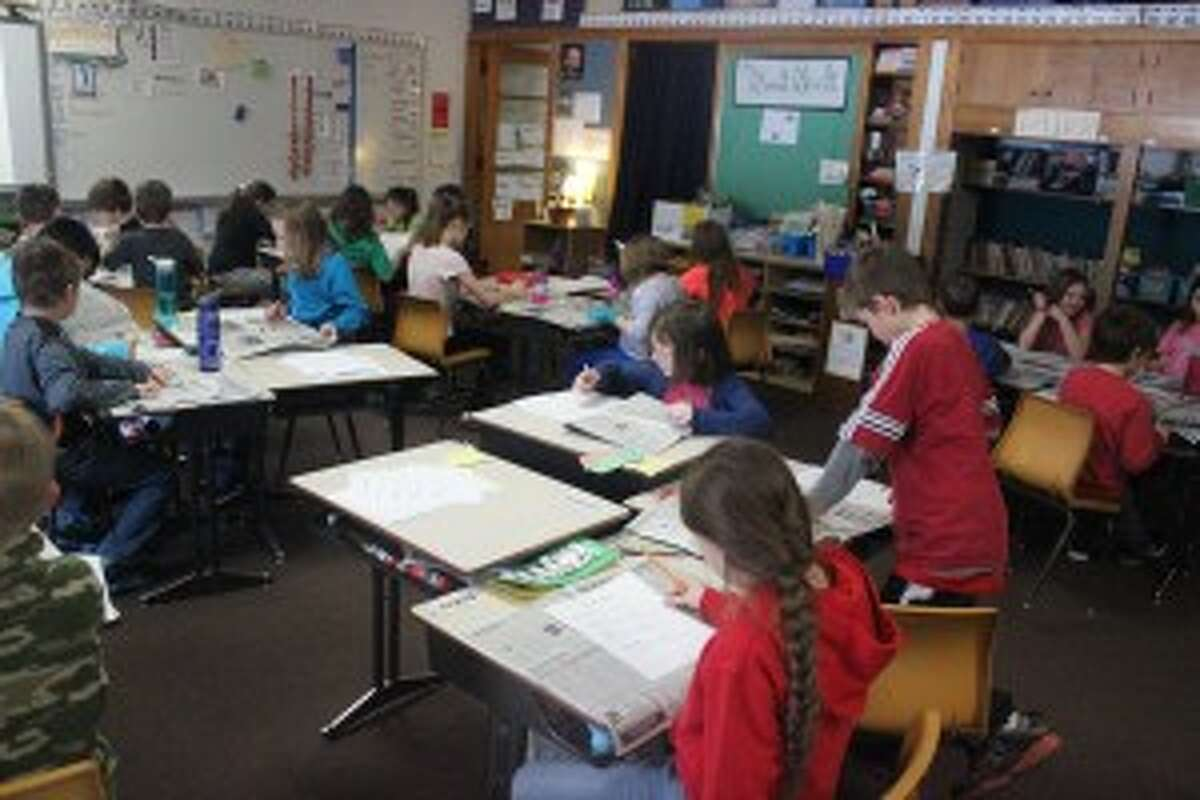PLATTE RIVER AT WORK: The student in Amy Jass' class at Platte River Elementary were hard at work during the Newspaper in Education lesson. The students are working to make their own issue of a newspaper, learning how by reading the Record Patriot.