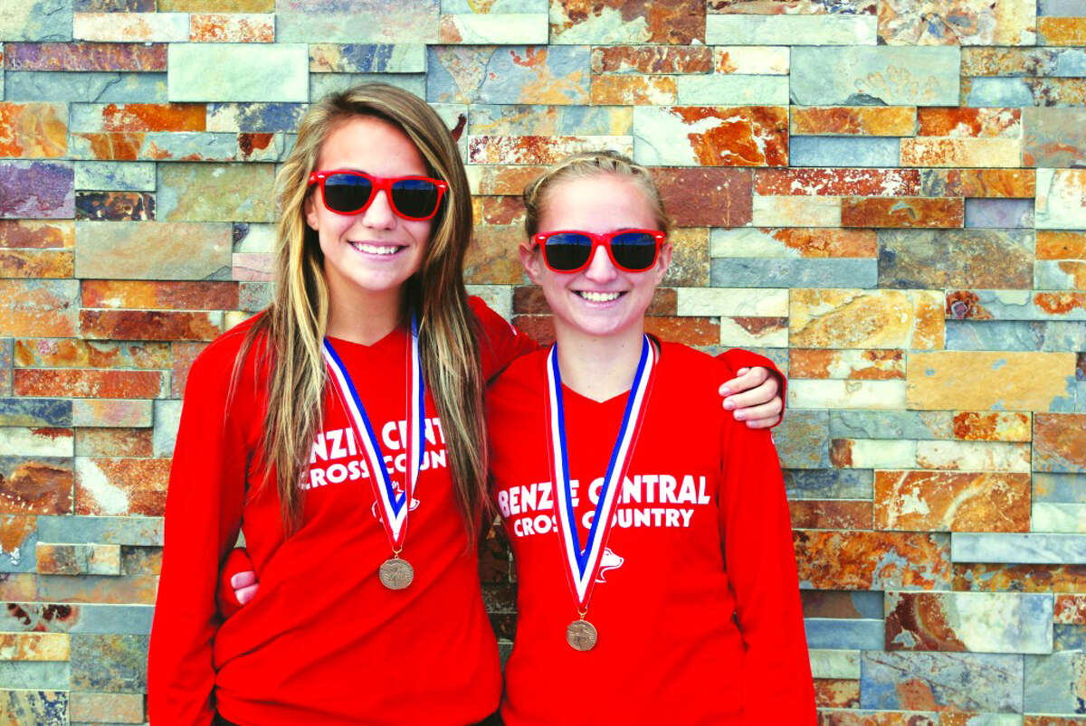 Benzie All State: Fleet of Foot: Alyssa Bennett (left) and Bryce Cutler helped Benzie Central's cross country team take 4th place overall at the MHSAA LP Cross Country Finals last fall. The girls team came in among the top 5 for the 6th year in a row, and the boys team finished in the top 10 for the 19th year in a row. (Photo/Bryan Warrick)