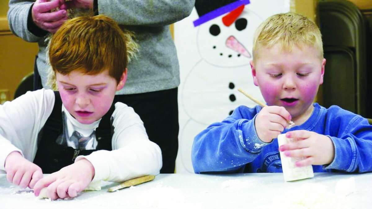 Carved in Soap: Lake Ann youngsters work intently on their soap carvings under the watchful eye of chaperones at Snow Pine Fest; a village festival meant to bring the community closer together and give residents a way to break their cabin fever.