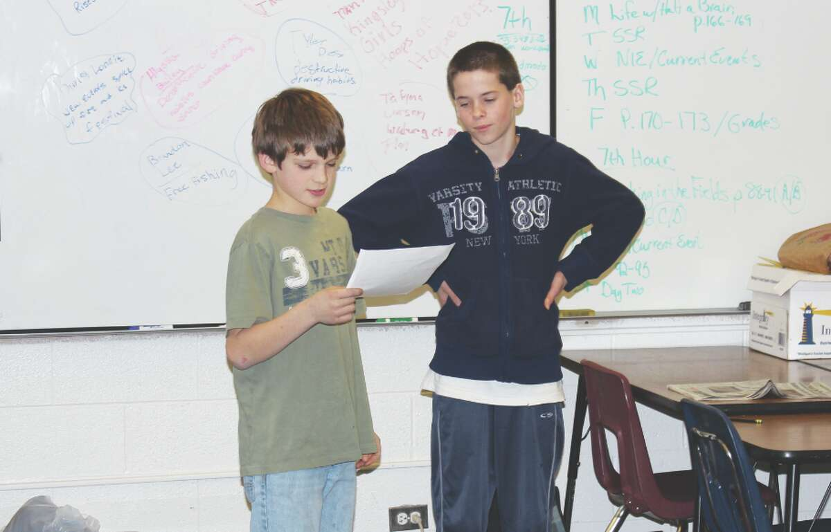 """NIE Presenting: Evan Kidder and Ethan Burgess present what they have found to the rest of the class. The students present what they have learned from the newspaper and tell what remaining questions they have about the story or source."""""""