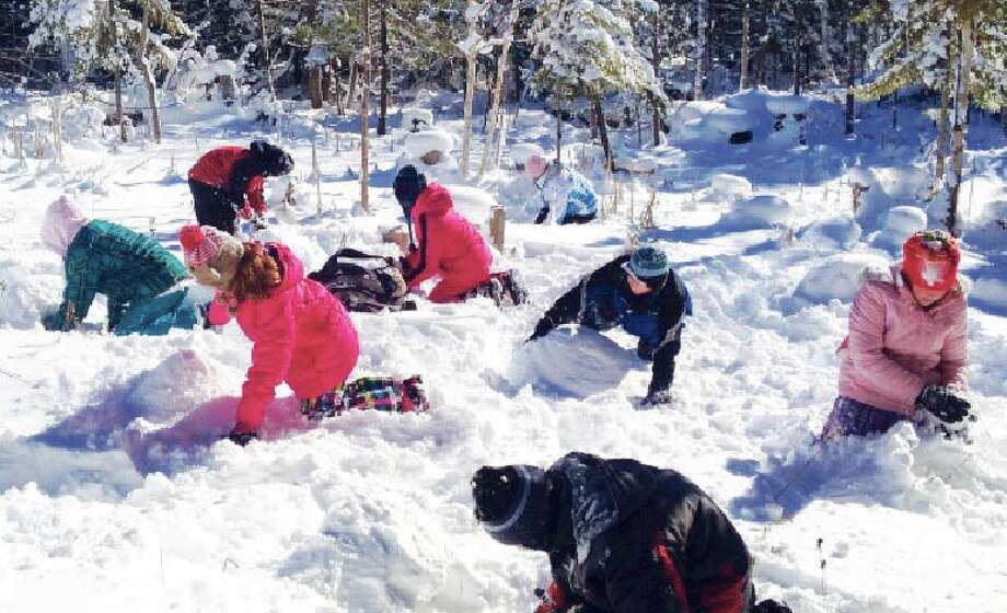 """Building shelter in the snow: Students build miniature quinzhee snow shelters with the challenge of keeping their """"Jello Babies"""" from freezing in the cold. It's another good survival skill to have."""""""