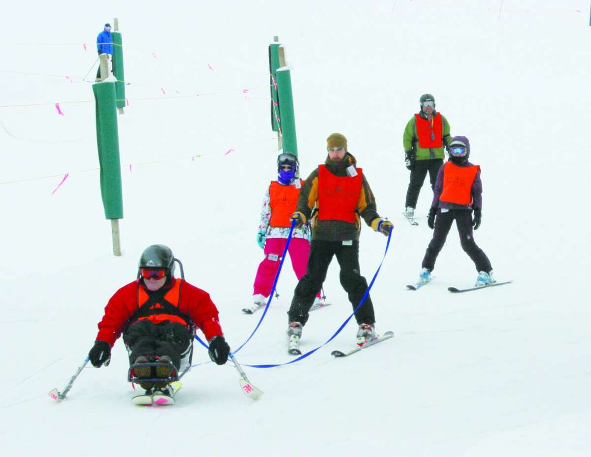 Leading the Pack: John Johnson rockets down the slopes at Crystal Mountain in the bi-ski, one of the several different types of adaptive equipment available to skiers. (Photo/Colin Merry)