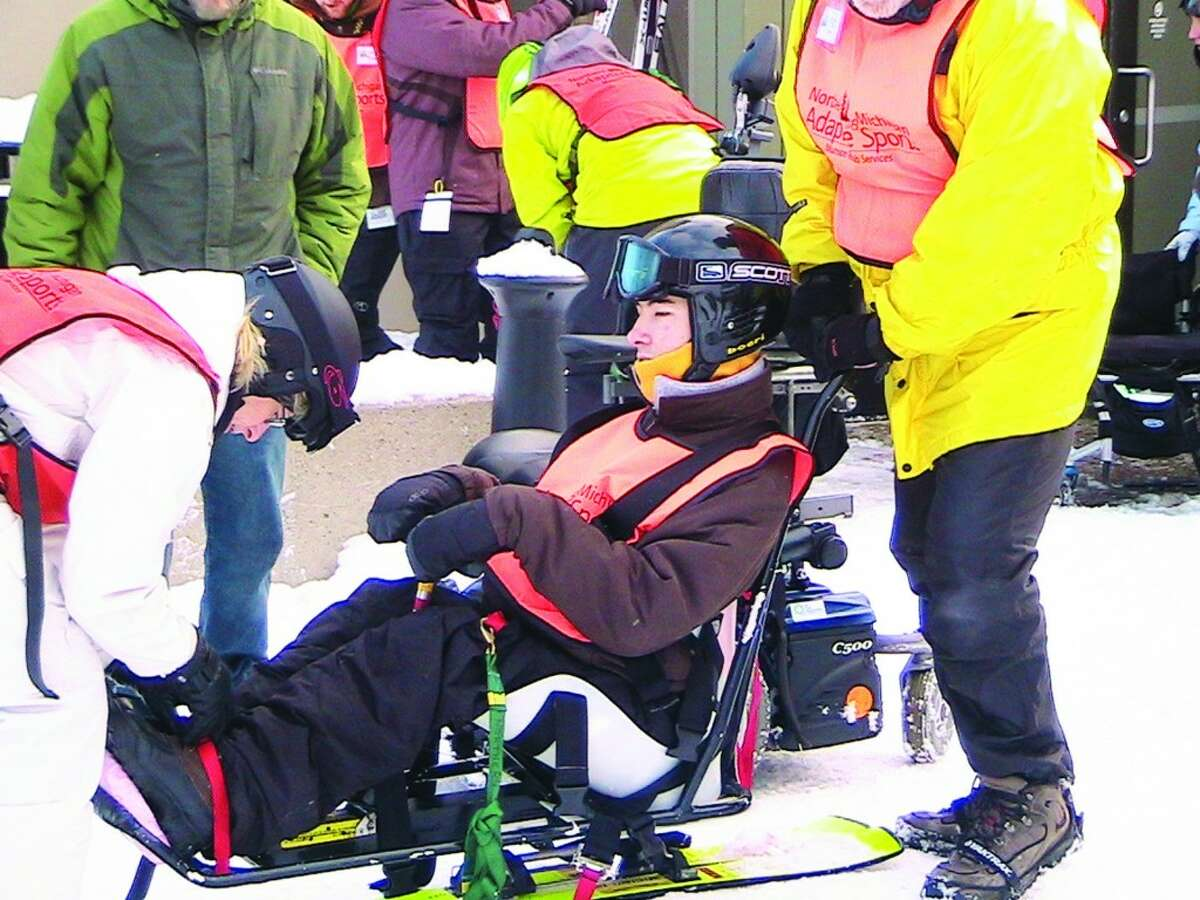 Strapped In: Nick Lonsdale, who has been skiing at Crystal with the adaptive program for 4 years, said using the equipment for the first time was a little daunting, but now he loves the rush he gets from shooting down the slopes. Lonsdale attends every ski day he can, and said without the adaptive ski program, he would never have known how fun skiing could be.