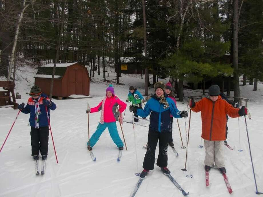 EXPLORING THE TRAILS: Lake Ann fifth graders go cross-country skiing during their winter camp at Camp Hayowentha near Traverse City. (Courtesy Photos)