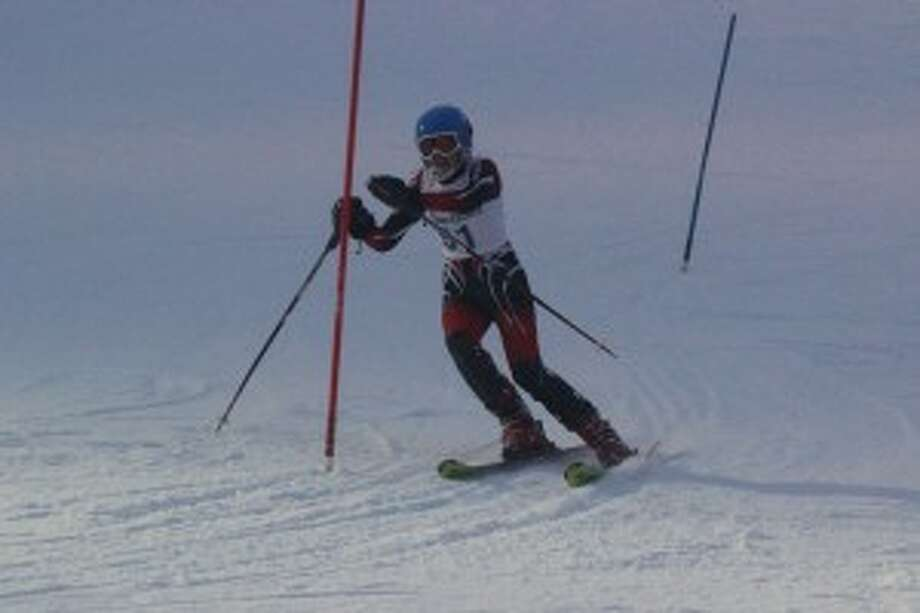 CONFERENCE RACE: Benzie skier Paige Papineau races during the conference meet at Crystal Mountain. (Photo/Bryan Warrick)