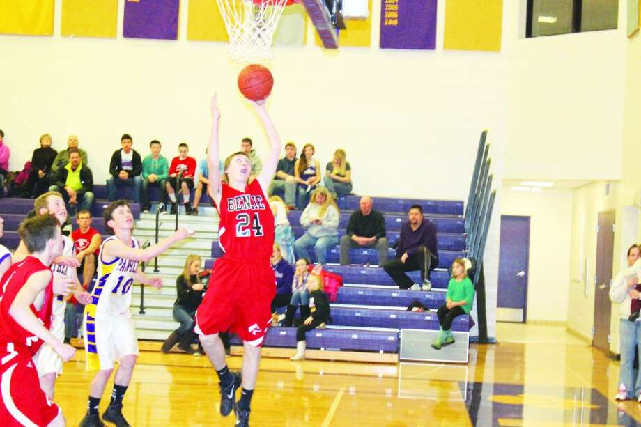 Benzie JV Passes FKT: Benzie freshman Austin Tharp jumps to put the ball in past the Panther defense.