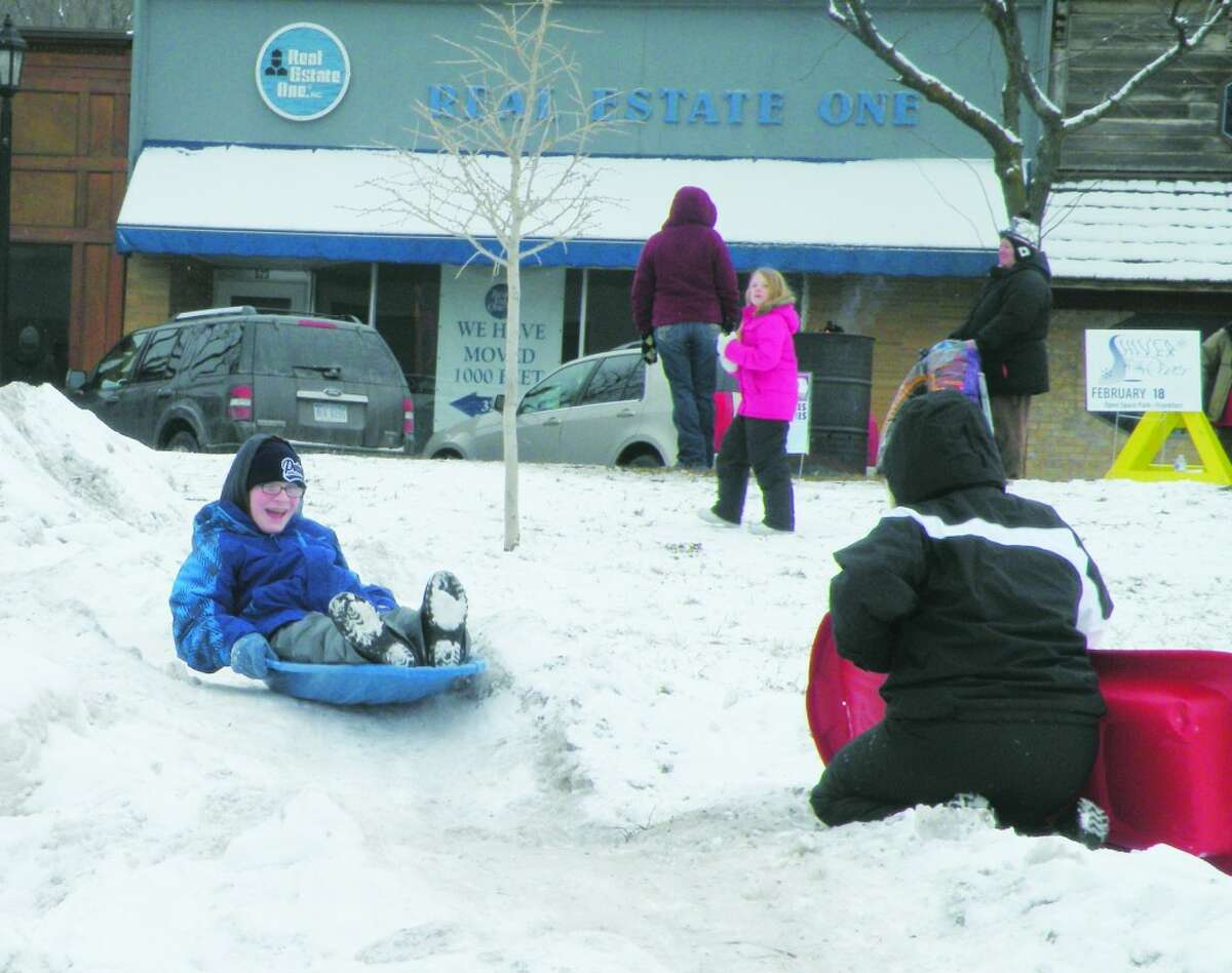 Slippery Slope: Children play on Snow Mountain at Frankfort's Shiver by the River winter festival, just one of the many children's activities taking place throughout the day.Other activities include bowling on Main Street, horse drawn carriage rides and lunch in the park.