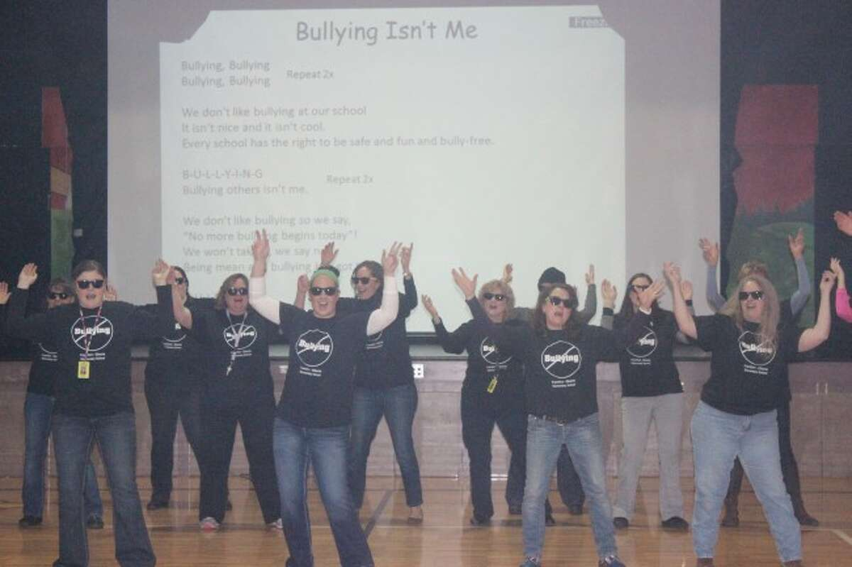 ROCKING TEACHERS: The teachers of Frankfort Elementary School lead the students in a song about stopping bullying during their assembly. (Photos/Bryan Warrick)