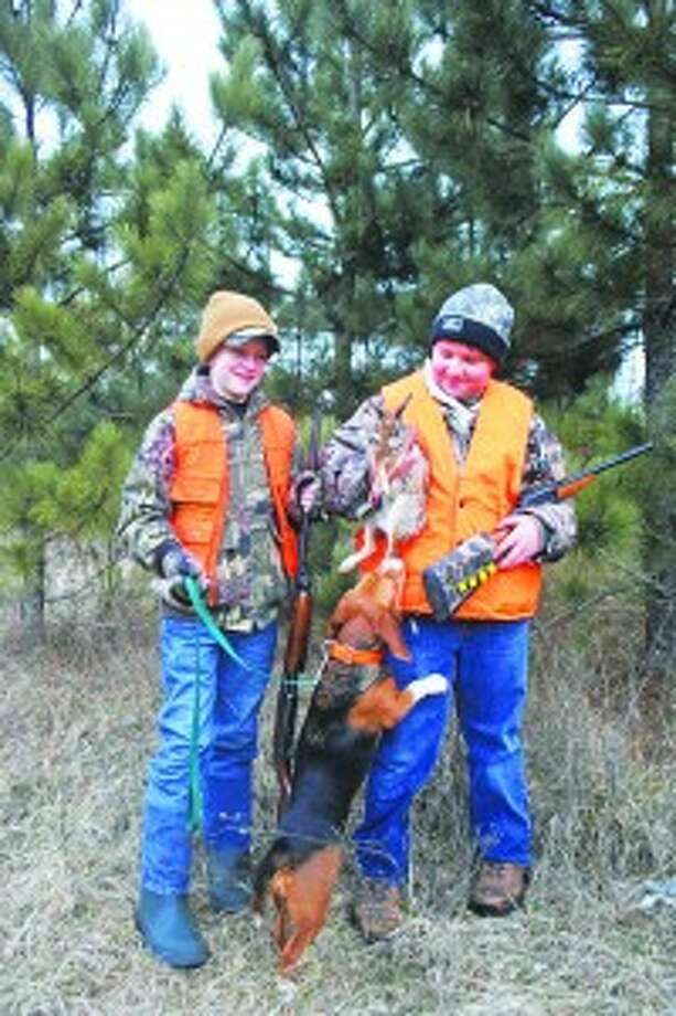 Creating Memories: Youth programs developed by the DNR are helping to encourage a new generation of Michigan hunters to get out into the woods and make their own hunting adventures.