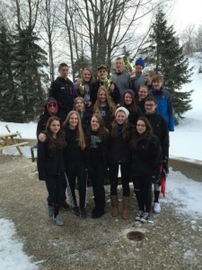 HOME CHAMPS: The Benzie/Frankfort joint ski team hold up their trophies after their home invite at Crystal Mountain. (Courtesy photo)