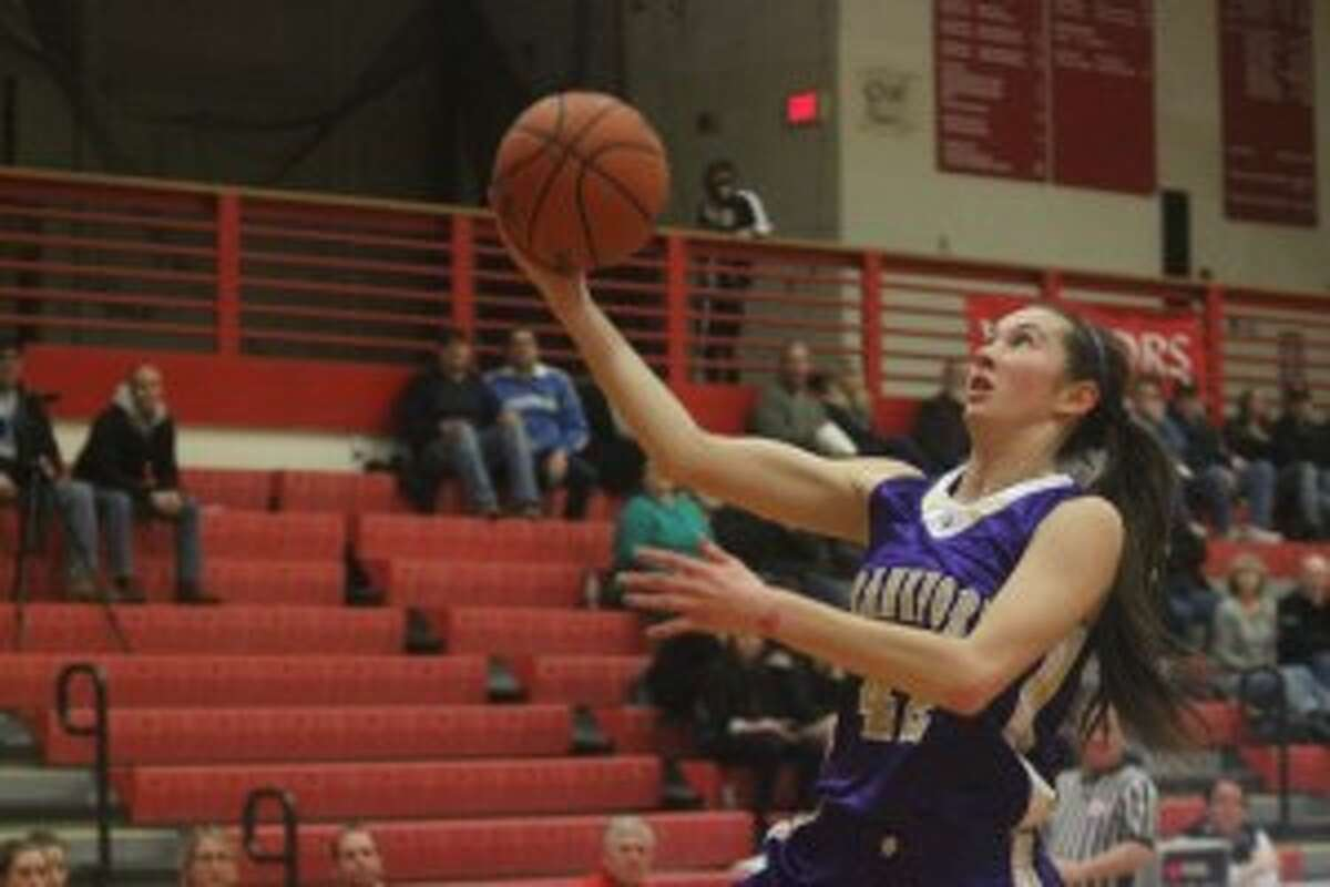 OVERCOMING STRUGGLES: MacKenna Kelly flies past the Suttons Bay defense to score. Despite struggling to score throughout the game, the Panthers managed to get the win, 45-41.