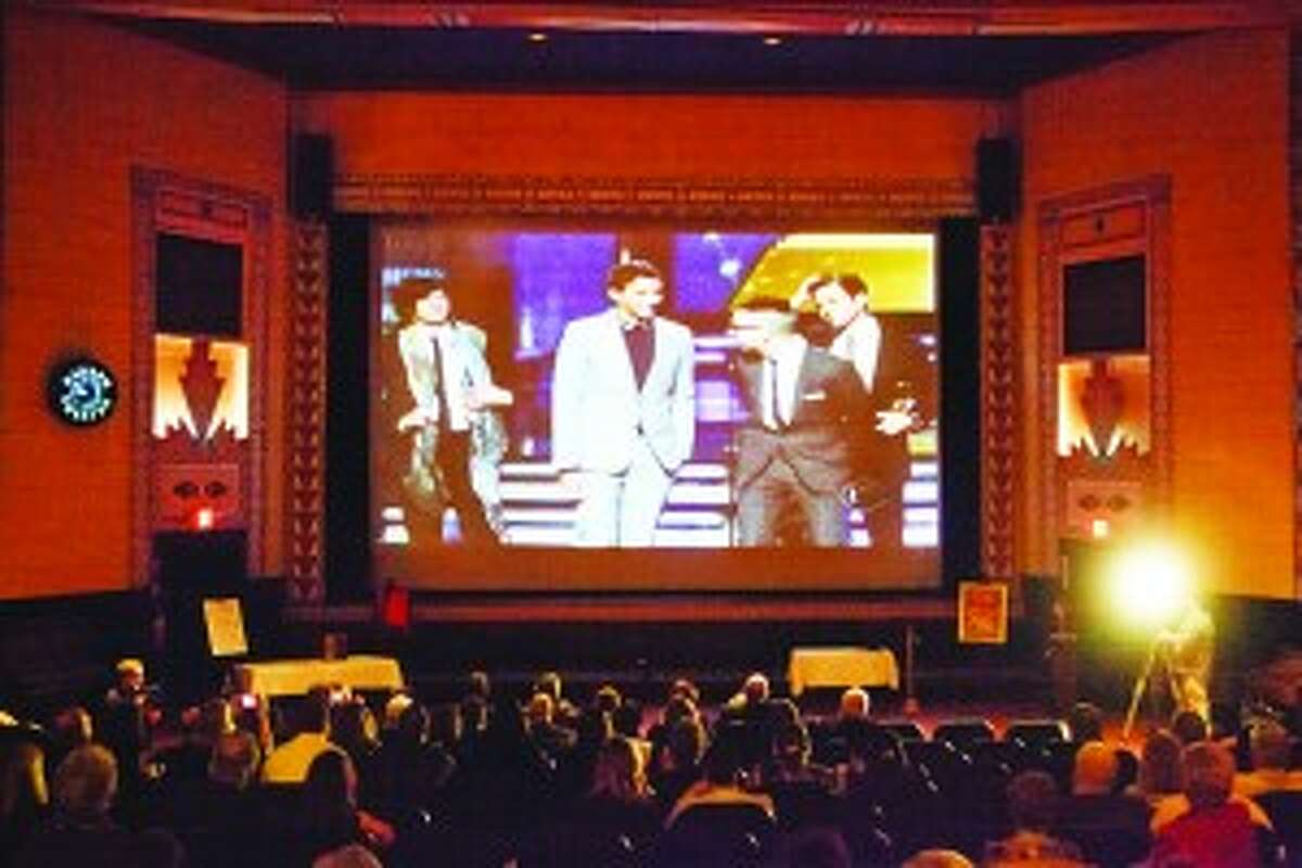 On the Big Screen: People watch as fun. performs on the big screen during the Grammy Awards. (Photo/Brian Confer)