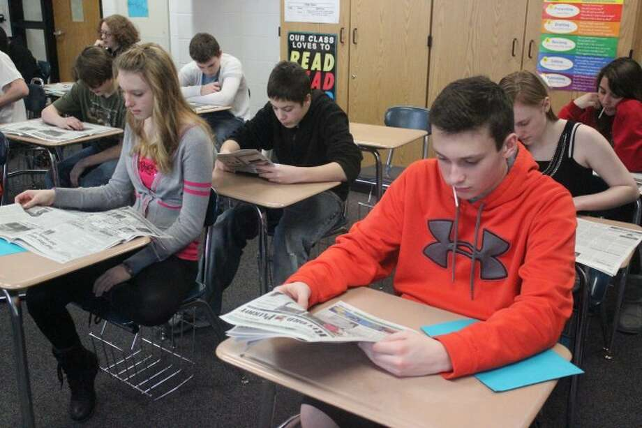 LOCAL IMPORTANCE: Eighth graders at Benzie Central MS read the Record Patriot during the Newspapers in Education program. The students use the paper as both a classroom tool and to learn more about local news and events that impact their lives. (photos/Bryan Warrick)