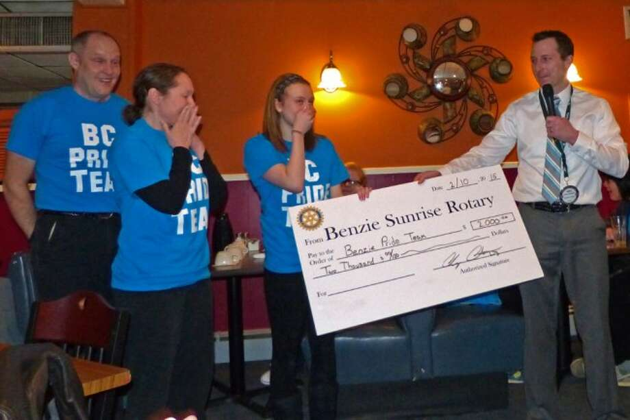ROTARY HELP: Sunrise President Andy Ashworth presents a Club check for $2,000 to the BC Pride Team's Allison Crossman during the Feb. 10 Rotary Meeting. (Courtesy photos)