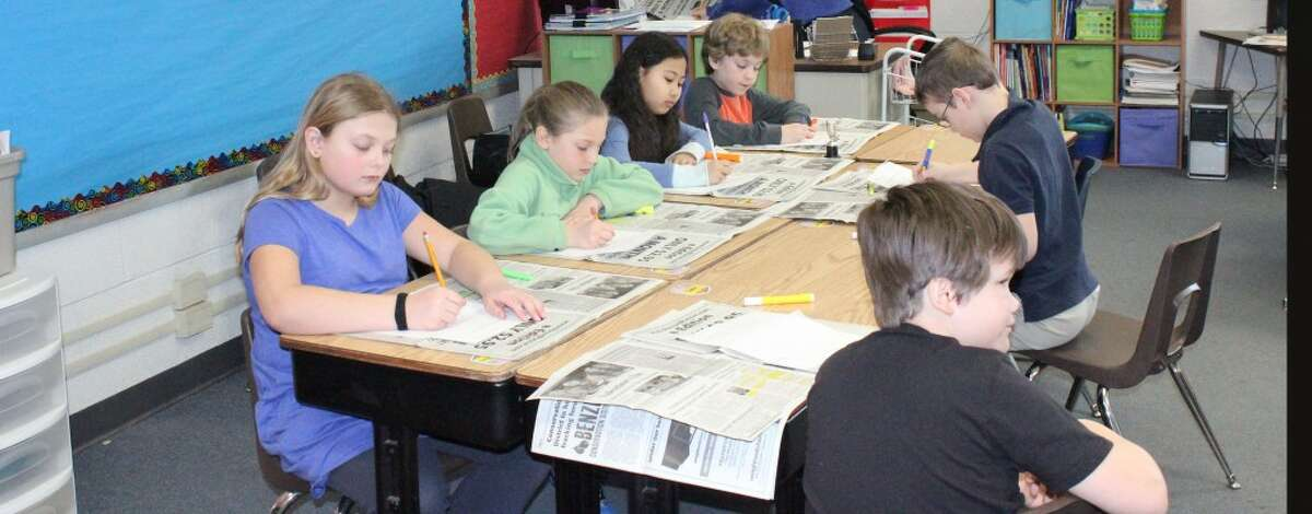 Looking for Facts: Third grade students read the paper, looking for facts that they think are interesting.