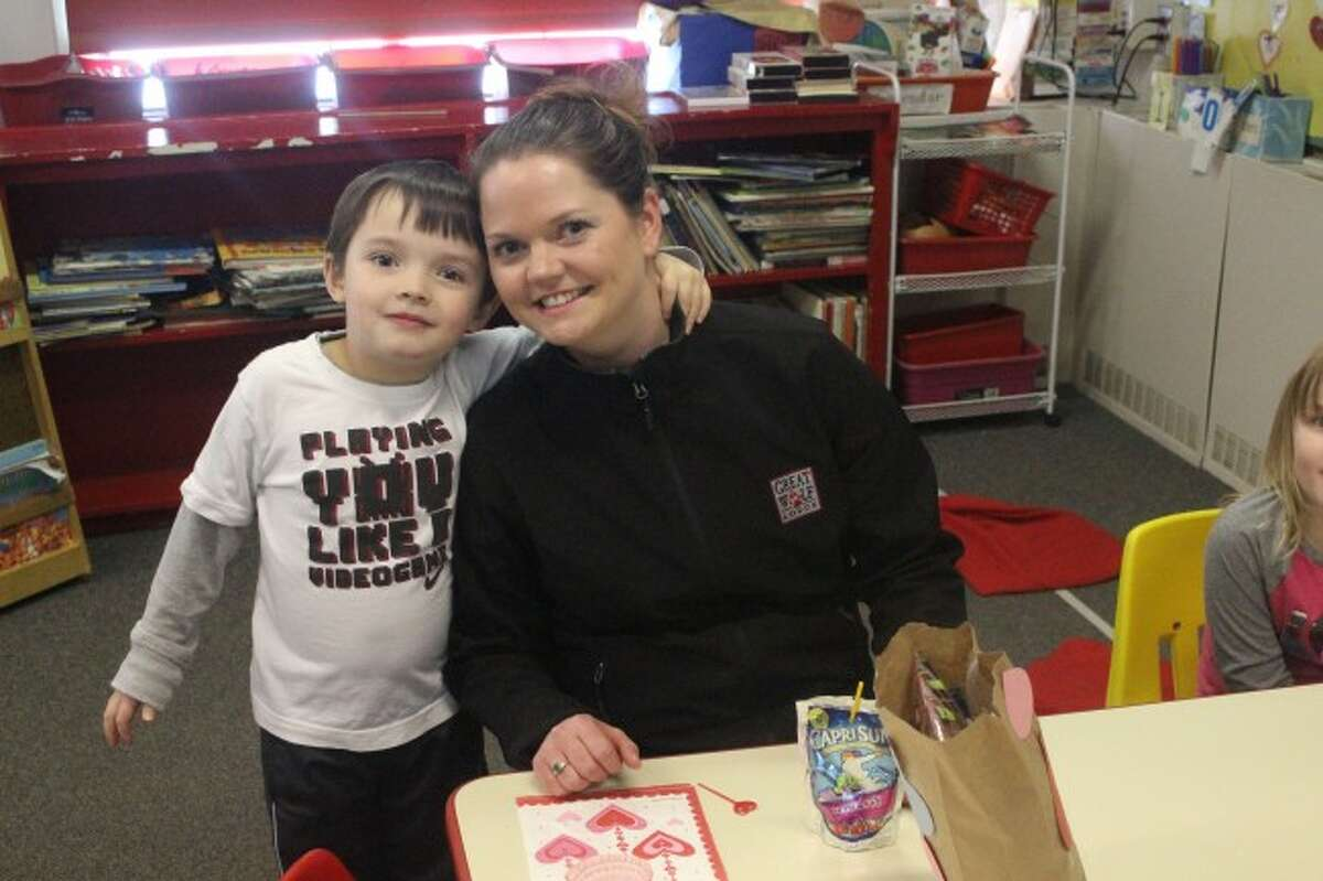 PARENTS GETTING IN THE FUN: The Valentines Day parties weren't just a fun time for the students, but also for the teachers and parents who volunteered to help out.