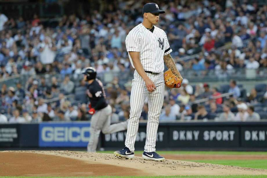 New York Yankees starting pitcher Jonathan Loaisiga waits as Cleveland Indians' Roberto Perez runs the bases after hitting a two-run home run during the first inning of a baseball game Thursday, Aug. 15, 2019, in New York. (AP Photo/Frank Franklin II) Photo: Frank Franklin II / Copyright 2019 The Associated Press. All rights reserved.