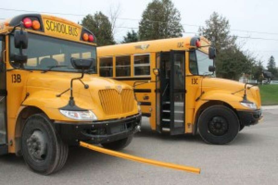 SAFETY FIRST: The Benzie School board released the bids for the final three school buses, the final group of a four year bond to modernize the fleet. Each bus comes with several new safety features, including the crossing gate, which makes students walk further in front of the bus, allowing the driver to see them over the tall front of the vehicle. (photo/Bryan Warrick)