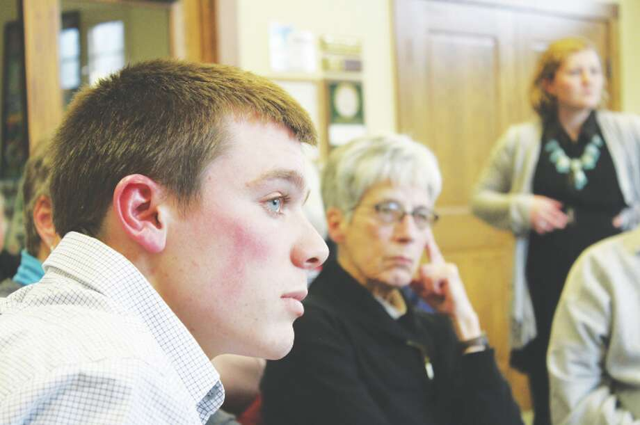 Park Planning: Michigan State University planning student Clay Hagen and Tree Board president Bonnie Warren listen intently as Frankfort residents list the strengths and weaknesses of Cannon Park and the Lake Michigan beachfront. (Photo/Colin Merry)