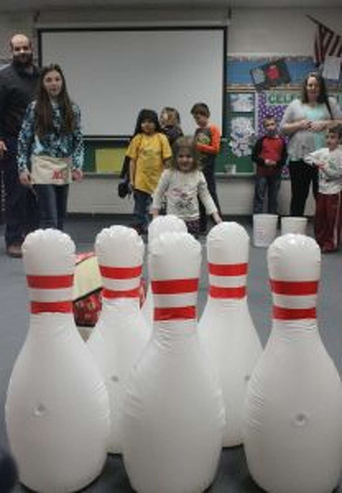 HAVING FUN: Smiles abounded at the many games at Crystal Lake Elementary's Winter Carnival.