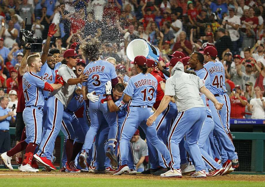 Philadelphia Phillies' Bryce Harper (3) celebrates his grand slam with teammates during the ninth inning of a baseball game against the Chicago Cubs, Thursday, Aug. 15, 2019, in Philadelphia. The Phillies won 7-5. (AP Photo/Chris Szagola) Photo: Chris Szagola / Associated Press