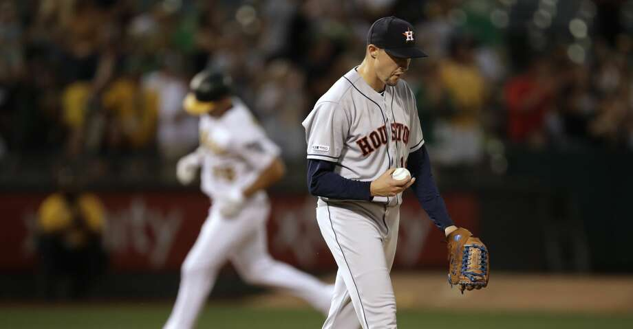 Houston Astros' Aaron Sanchez, right, walks back to the mound after giving up a three-run home run to Oakland Athletics' Matt Olson, rear, in the fourth inning of a baseball game Thursday, Aug. 15, 2019, in Oakland, Calif. (AP Photo/Ben Margot) Photo: Ben Margot/Associated Press