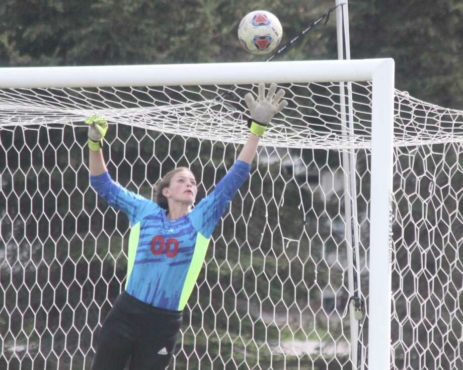 Maile Church makes a leaping save on a shot.