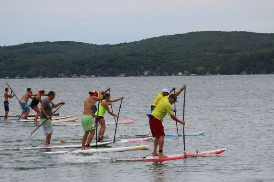 PADDLEBOARD CLASSIC: After a two-hour delay, the Up North Standup Paddleboard Classic gets underway on Crystal Lake. (Photo/Colin Merry)