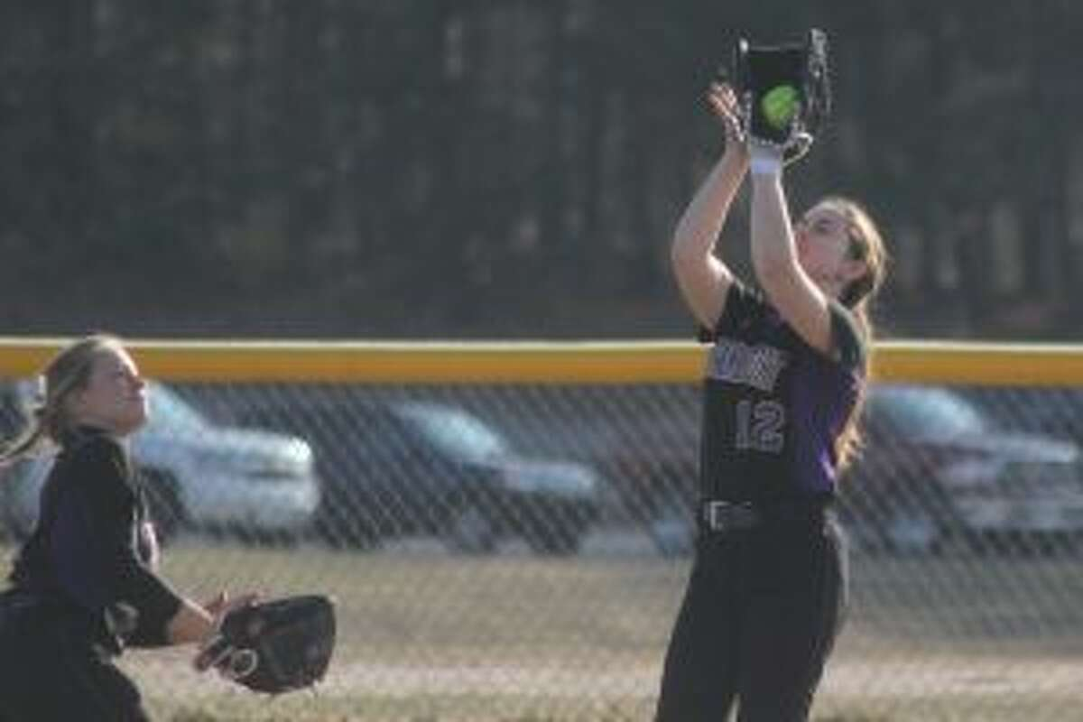 Cora Scott runs in from her right field position to catch a shallow fly ball. (Photo/Robert Myers)