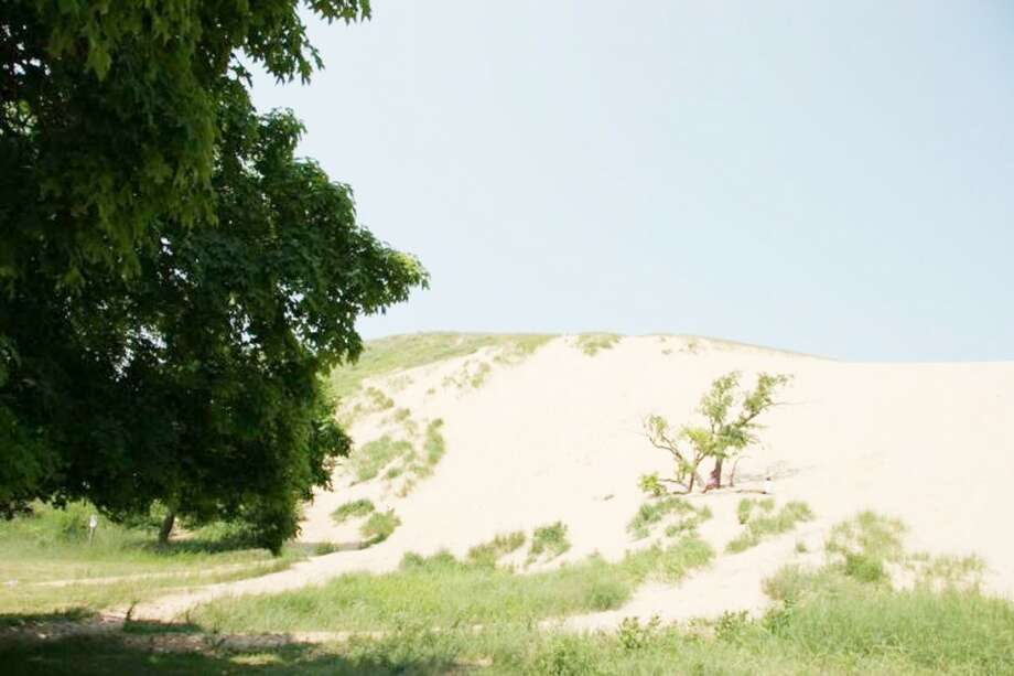 DUNE CLIMB: The National Park Services will be celebrating it's 97th birthday on Sunday with free admission to entrance and tour fees throughout the Sleeping Bear Dunes National Lakeshore. (Courtesy Photo)