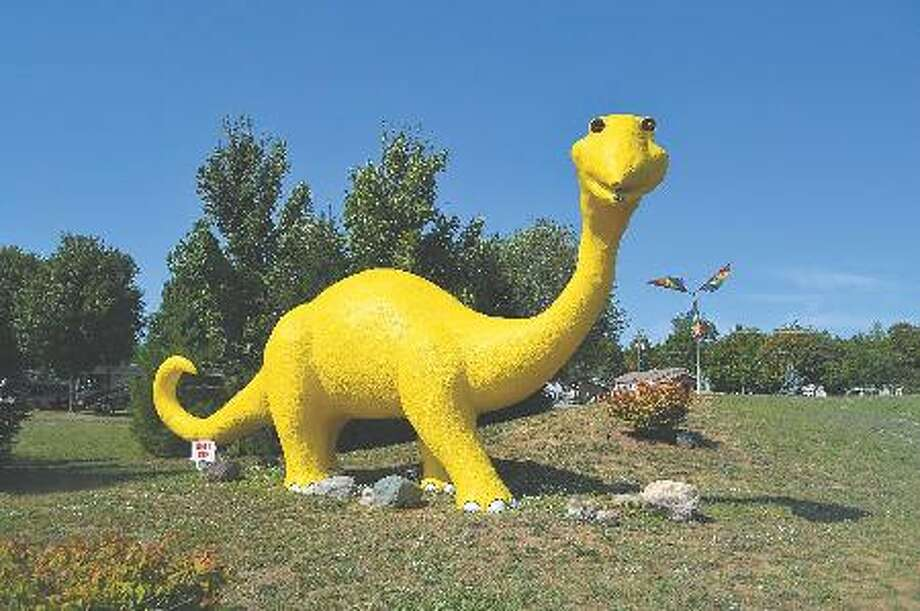 Kampvilla's big yellow dinosaur has been an iconic landmark for those driving along US-31.