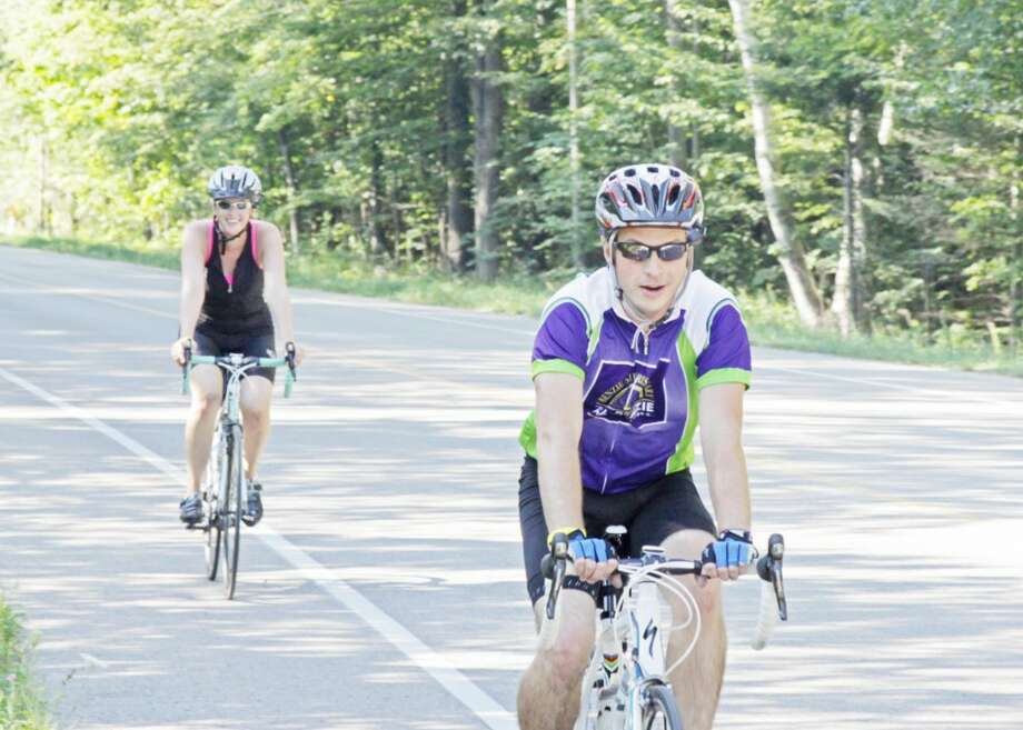 VISITING RIDERS: Brighton riders John and Betsy Lord coming down Platte Road during the Bike Benzie Tour on August 18. The even has grown in the last five years, as riders from around the state and the Midwest now come and take part in the race. (Courtesy Photo)