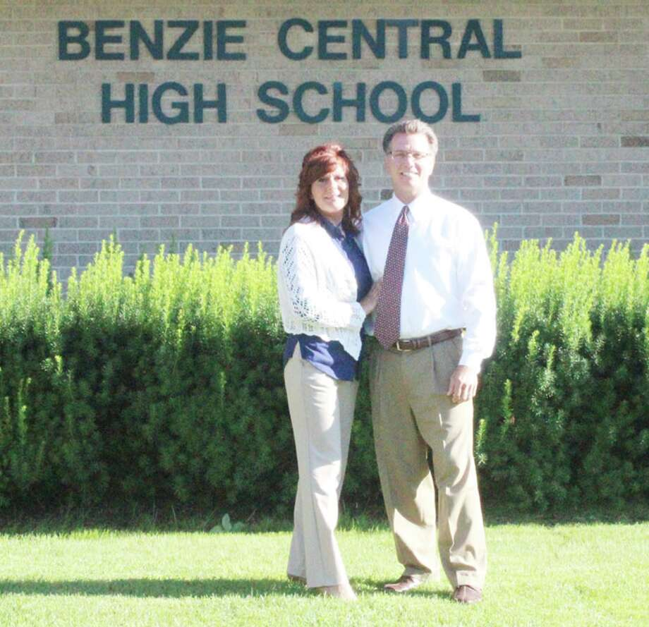 NEW PRINCIPAL: New Benzie Central High School principalLarry Haughn and his wife Vicki were welcomed by the school board at its Aug. 8 meeting. (Photo/Bryan Warrick)