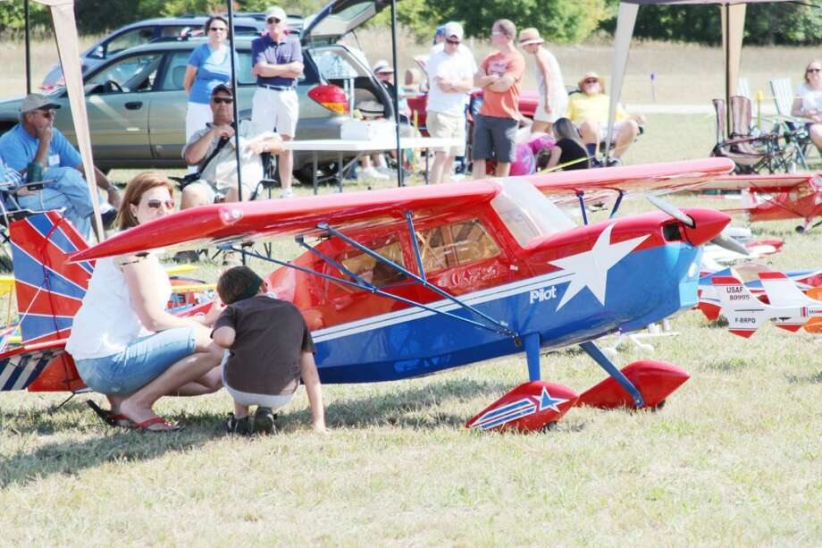 BIG ONE: One of the larger aircraft at the Benzie Area Radio Control Club's Air Show was a model civilian aircraft interests several visitors.