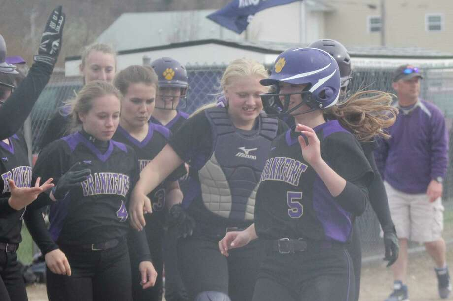 Haley Myers is congratulated by her teammates after a home run.