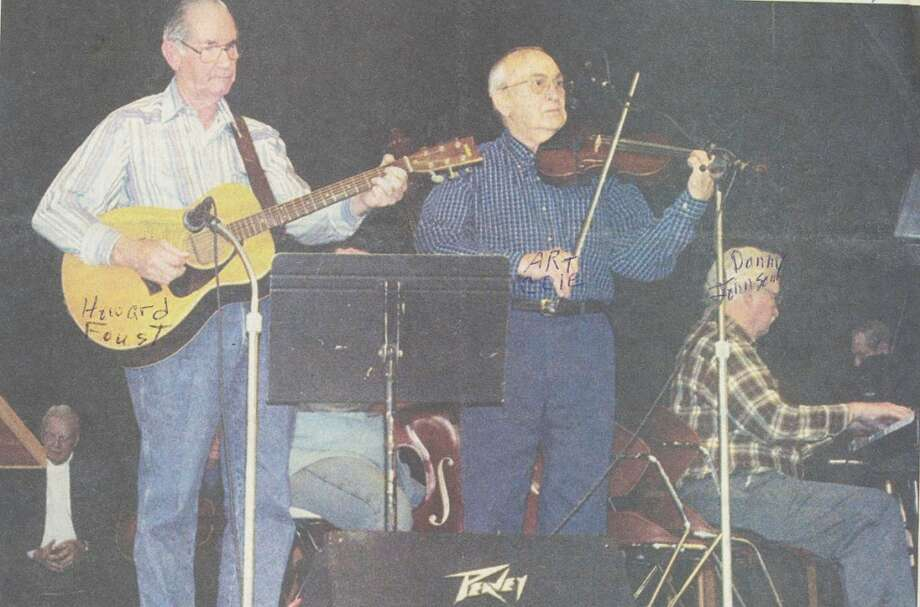 FIDDLER CONCERT: Howard Foust, of Honor (left), performs alongside Art Kole, of Alpena, during the Fiddler's Jamboree in Honor. The event is organized by Foust, along with his wife Mabel, and Oscar Jaquish. (Courtesy Photo)