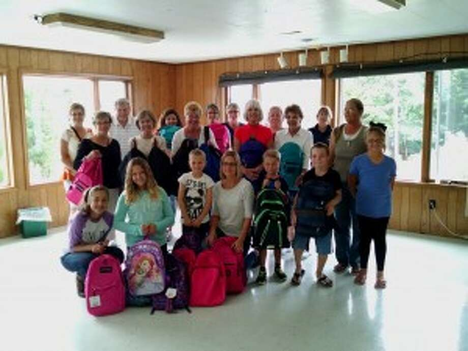 Project Backpack saw a strong turnout to stuff 150 backpacks with items area students will need throughout the year.
